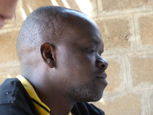 Penningmeester Justine Ojambo